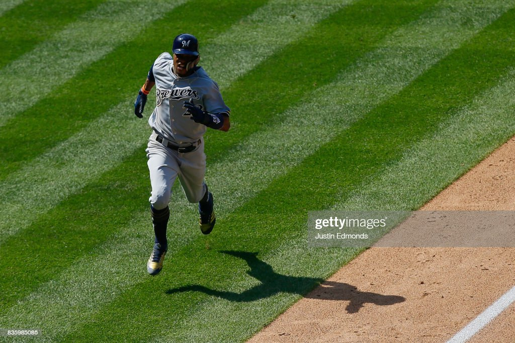 Keon Broxton #23 of the Milwaukee Brewers runs in to score during the sixth inning during the game against the Colorado Rockies at Coors Field on August 20, 2017 in Denver, Colorado.