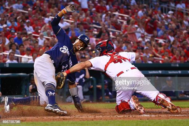 Keon Broxton of the Milwaukee Brewers scores a run against Eric Fryer of the St Louis Cardinals in the fourth inning at Busch Stadium on June 13 2017...