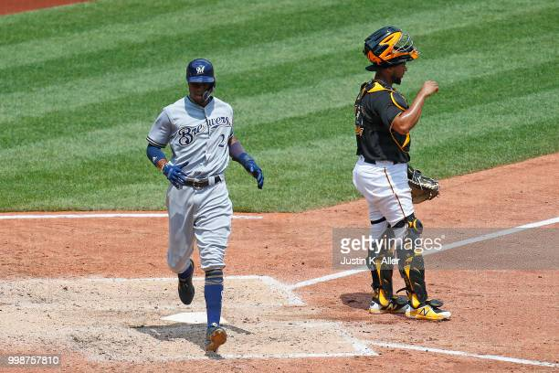 Keon Broxton of the Milwaukee Brewers scores on a RBI single in the fifth inning during game one of a doubleheader against the Pittsburgh Pirates at...