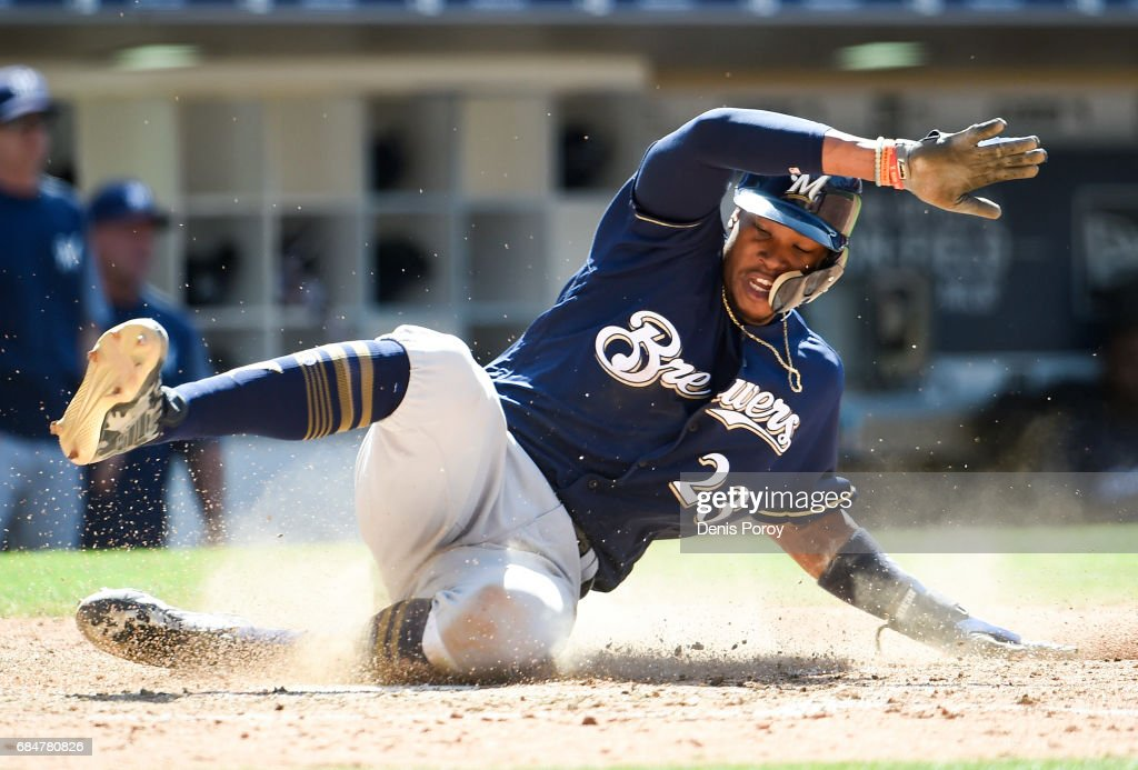 Keon Broxton #23 of the Milwaukee Brewers slides as he scores during the ninth inning of a baseball game against the San Diego Padres at PETCO Park on May 18, 2017 in San Diego, California.