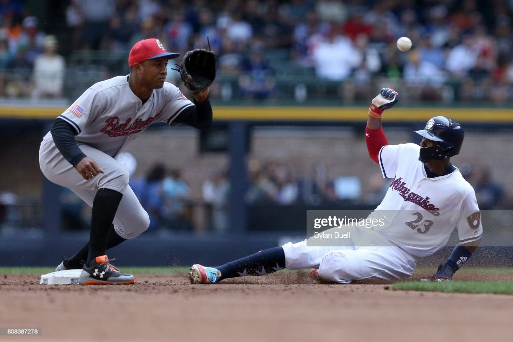 Keon Broxton #23 of the Milwaukee Brewers steals second base ahead of the throw to Jonathan Schoop #6 of the Baltimore Orioles in the second inning at Miller Park on July 4, 2017 in Milwaukee, Wisconsin.