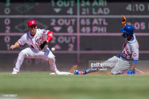 Keon Broxton of the New York Mets steals second base in front of Brian Dozier of the Washington Nationals during the inning at Nationals Park on...
