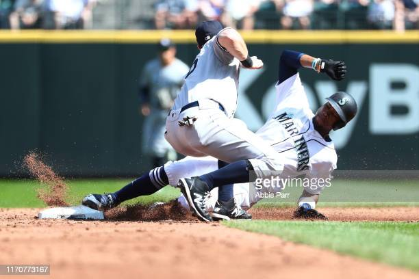 Keon Broxton of the Seattle Mariners is forced trying to steal second base by DJ LeMahieu of the New York Yankees in the fourth inning during their...