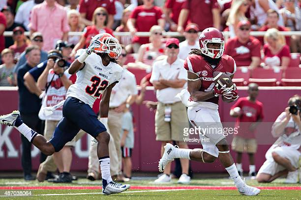 Keon Harcher of the Arkansas Razorbacks catches a touchdown pass over Kalon Beverly of the UTEP Miners at Donald W Reynolds Razorback Stadium on...