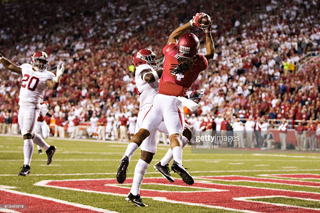 Keon Hatcher #4 of the Arkansas Razorbacks catches a touchdown pass over Ronnie Harrison #15 of the Alabama Crimson Tide at Razorback Stadium on October 8, 2016 in Fayetteville, Arkansas. The Crimson Tide defeated the Razorbacks 49-30.