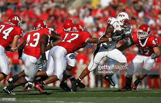 Keon Lattimore of the Maryland Terrapins runs through the Rutgers Scarlet Knights defense during their game at Rutgers Stadium on September 29 2007...