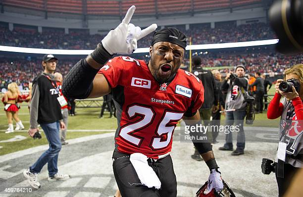 Keon Raymond of the Calgary Stampeders celebrates after defeating the Hamilton TigerCats to win the 102nd Grey Cup Championship Game at BC Place...