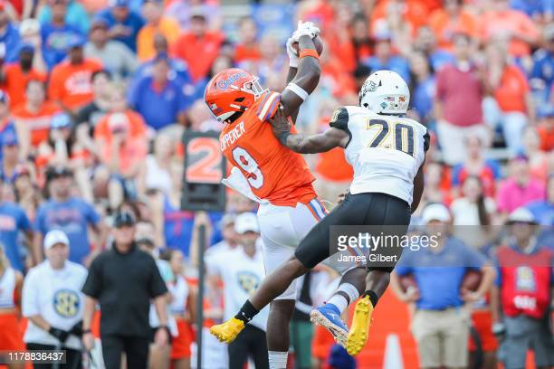 Keon Zipperer of the Florida Gators catches a pass against Mantriel Reaves of the Towson Tigers during the first half of a game at Ben Hill Griffin...