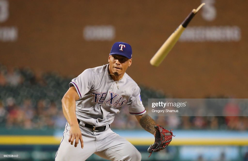 Keone Kela #50 of the Texas Rangers avoids a broken bat in the ninth inning while playing the Detroit Tigers at Comerica Park on July 5, 2018 in Detroit, Michigan. Texas won the game 7-5.