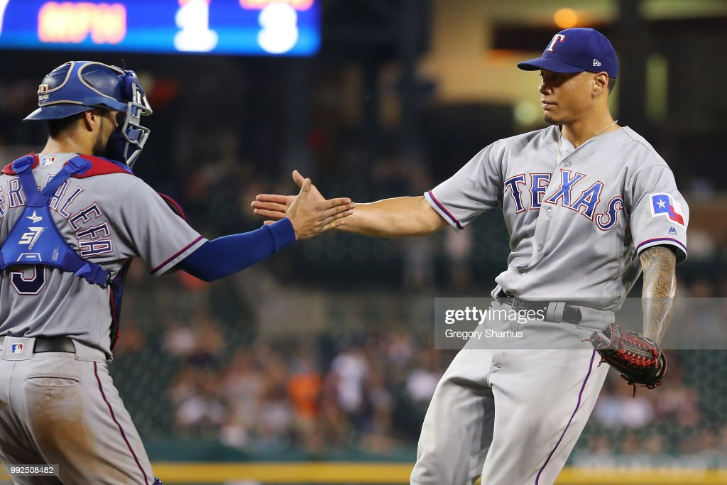 Keone Kela #50 of the Texas Rangers celebrates a 7-5 win over the Detroit Tigers with Isiah Kiner-Falefa #9 at Comerica Park on July 5, 2018 in Detroit, Michigan. Texas won the game 7-5.