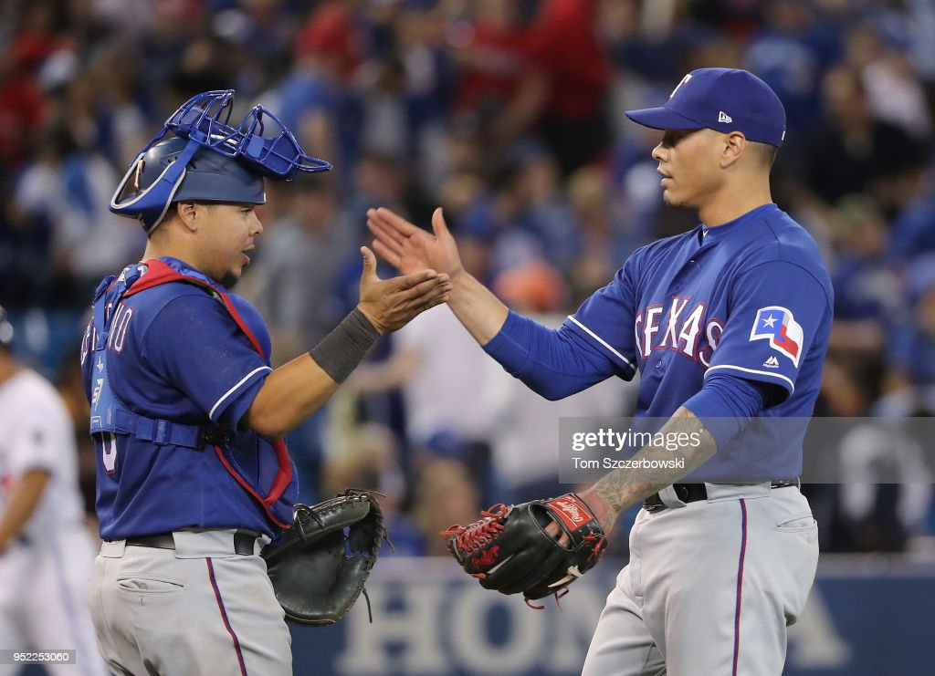 Keone Kela #50 of the Texas Rangers celebrates their victory with Juan Centeno #8 during MLB game action against the Toronto Blue Jays at Rogers Centre on April 27, 2018 in Toronto, Canada.