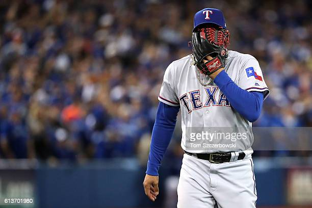 Keone Kela of the Texas Rangers reacts after getting the last out of the sixth inning against the Toronto Blue Jays during game three of the American...