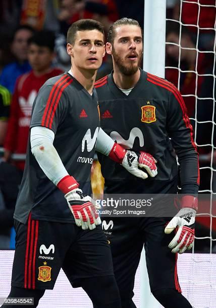 Kepa Arrizabalaga and David De Gea of Spain warm up during the international friendly match between Spain and Argentina at Wanda Metropolitano...