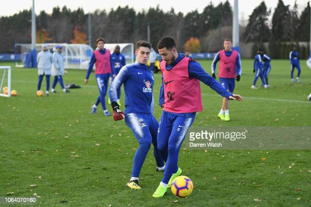 Kepa Arrizabalaga and Eden Hazard of Chelsea during a training session at Chelsea Training Ground on November 21 2018 in Cobham England