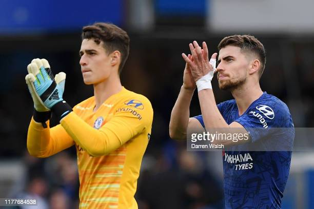 Kepa Arrizabalaga and Jorginho of Chelsea applauds fans following victory in during the Premier League match between Chelsea FC and Brighton Hove...