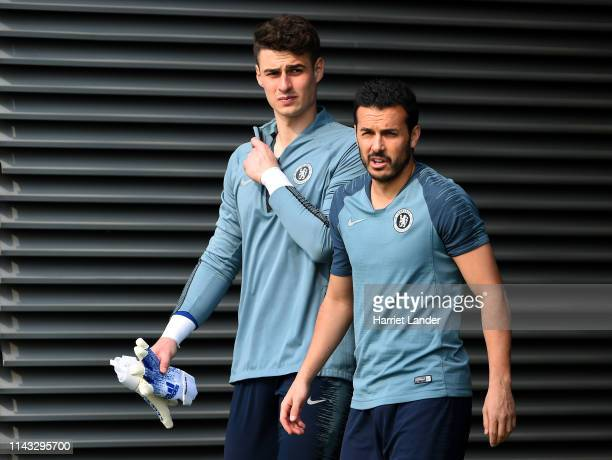 Kepa Arrizabalaga and Pedro of Chelsea walk out prior to a Chelsea training session at Chelsea Training Ground on April 17 2019 in Cobham England