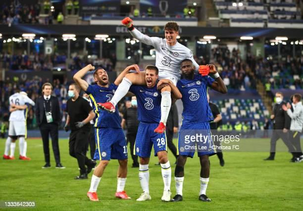 Kepa Arrizabalaga celebrates with teammates Mateo Kovacic. Cesar Azpilicueta and Antonio Ruediger following their side's victory in the UEFA Super...