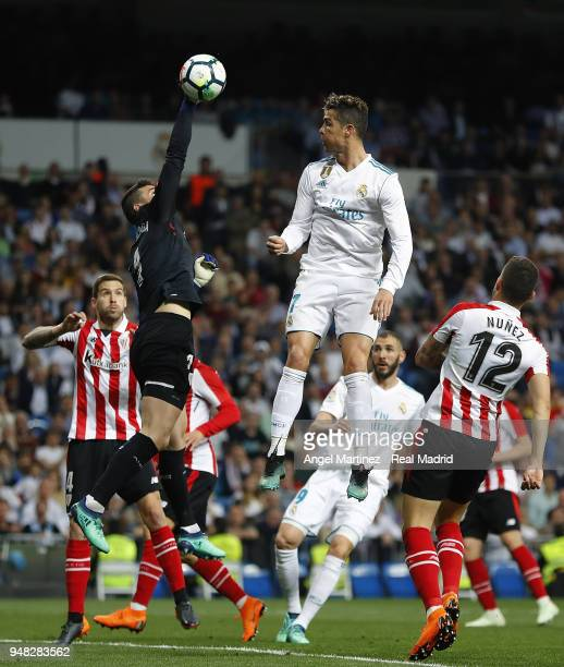 Kepa Arrizabalaga of Athletic Club competes for the ball with Cristiano Ronaldo of Real Madrid during the La Liga match between Real Madrid and...