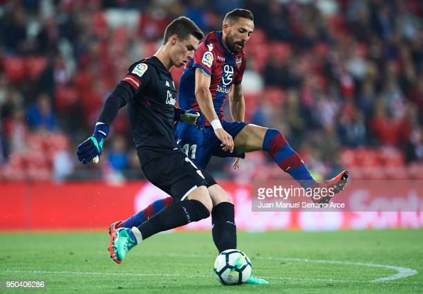 Kepa Arrizabalaga of Athletic Club is challenged by Jose Luis Morales of Levante UD during the La Liga match between Athletic Club and Levante at...