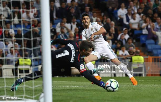 Kepa Arrizabalaga of Athletic Club saves a ball from of Marco Asensio Real Madrid during the La Liga match between Real Madrid and Athletic Club at...