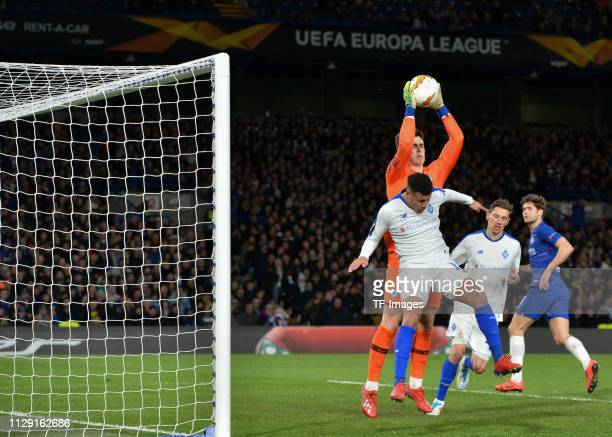 Kepa Arrizabalaga of Chelsea and Sidcley of Dynamo Kyiv battle for the ball during the UEFA Europa League Round of 16 First Leg match between Chelsea...