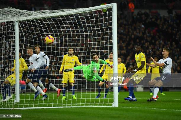 Kepa Arrizabalaga of Chelsea can't stop a header from Dele Alli of Tottenham Hotspur hitting the back of the net during the Premier League match...