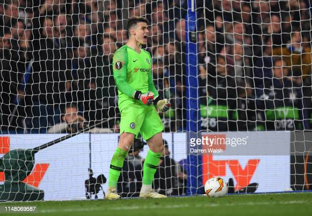 Kepa Arrizabalaga of Chelsea celebrates after saving a penalty from Martin Hinteregger of Eintracht Frankfurt in the penalty shoot out during the...