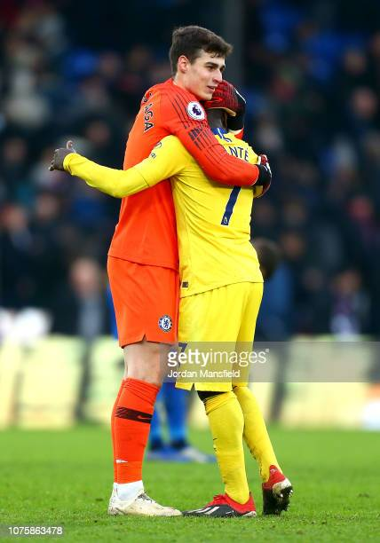 Kepa Arrizabalaga of Chelsea celebrates victory with N'golo Kante of Chelsea after the Premier League match between Crystal Palace and Chelsea FC at...