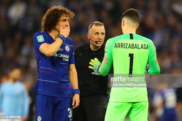 Kepa Arrizabalaga of Chelsea chats with referee Jonathan Moss as he is called to be substituted during the Carabao Cup Final between Chelsea and...