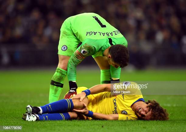 Kepa Arrizabalaga of Chelsea checks on David Luiz of Chelsea as he goes down injured during the Premier League match between Tottenham Hotspur and...