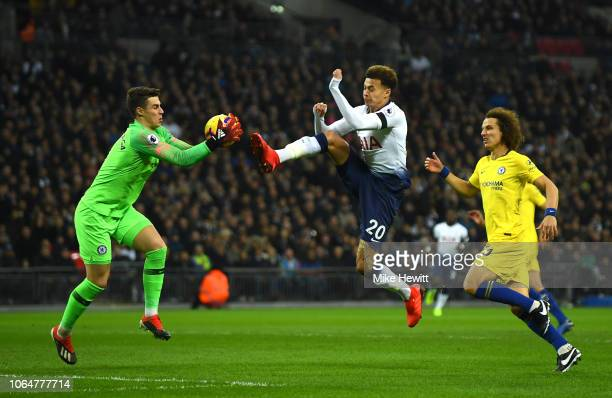 Kepa Arrizabalaga of Chelsea collects the ball from Dele Alli of Tottenham Hotspur during the Premier League match between Tottenham Hotspur and...