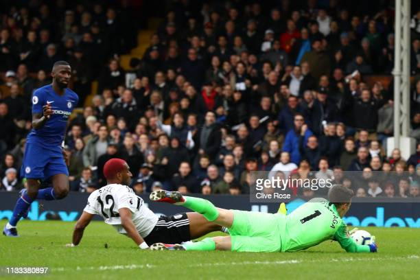 Kepa Arrizabalaga of Chelsea collects the ball under pressure from Ryan Babel of Fulham during the Premier League match between Fulham FC and Chelsea...