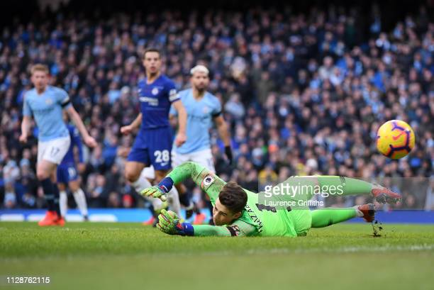 Kepa Arrizabalaga of Chelsea concedes the fourth goal scored by Ilkay Gundogan of Manchester City during the Premier League match between Manchester...