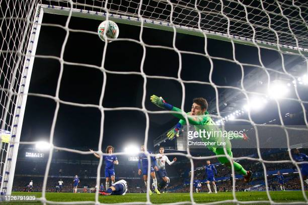 Kepa Arrizabalaga of Chelsea dives to try and stop the goal scored by Fernando Llorente of Tottenham Hotspur during the Carabao Cup SemiFinal Second...