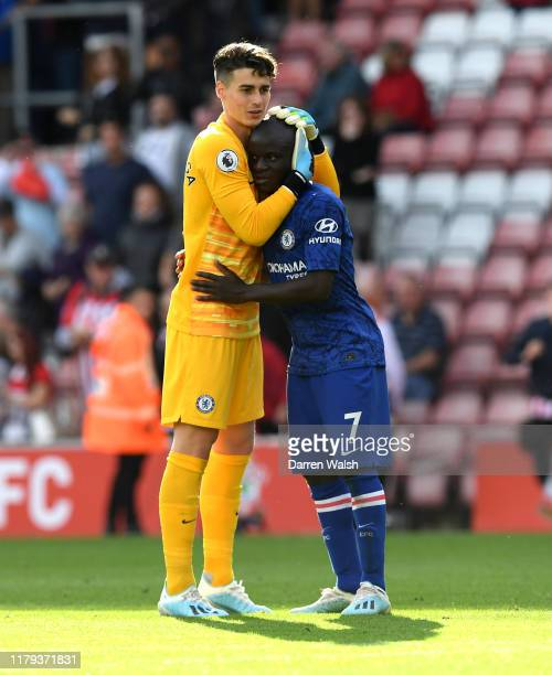 Kepa Arrizabalaga of Chelsea embraces N'Golo Kante of Chelsea following their sides victory in the Premier League match between Southampton FC and...