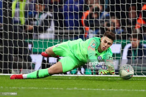 Kepa Arrizabalaga of Chelsea fails to save a penalty from Sergio Aguero of Manchester City in the shoot out during the Carabao Cup Final between...