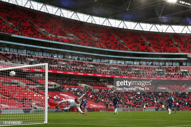 Kepa Arrizabalaga of Chelsea fails to save Leicester City's first goal scored by Youri Tielemans of Leicester City as fans watch on in the stand...