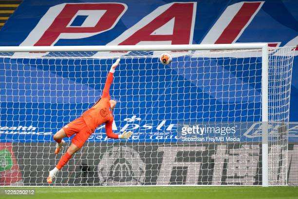 Kepa Arrizabalaga of Chelsea FC diving to concede goal from Wilfried Zaha of Crystal Palace shot during the Premier League match between Crystal...