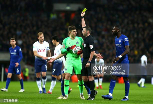 Kepa Arrizabalaga of Chelsea FC is awarded a yellow card during the Carabao Cup Semi Final First Leg match between Tottenham Hotspur and Chelsea at...