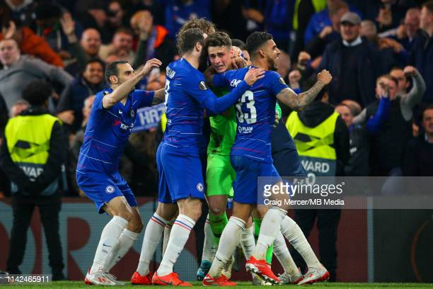 Kepa Arrizabalaga of Chelsea is embraced by team mates in the victory celebrations after the UEFA Europa League Semi Final Second Leg match between...