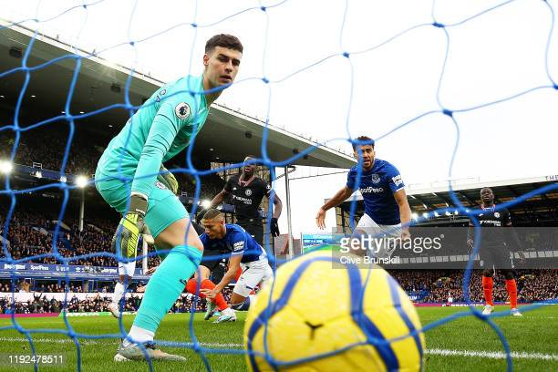 Kepa Arrizabalaga of Chelsea looks on as Richarlison of Everton scores his team's first goal during the Premier League match between Everton FC and...