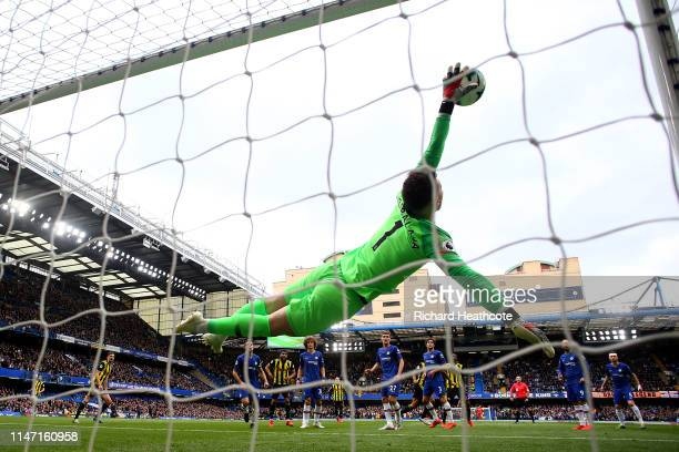 Kepa Arrizabalaga of Chelsea makes a save from Troy Deeney of Watford during the Premier League match between Chelsea FC and Watford FC at Stamford...