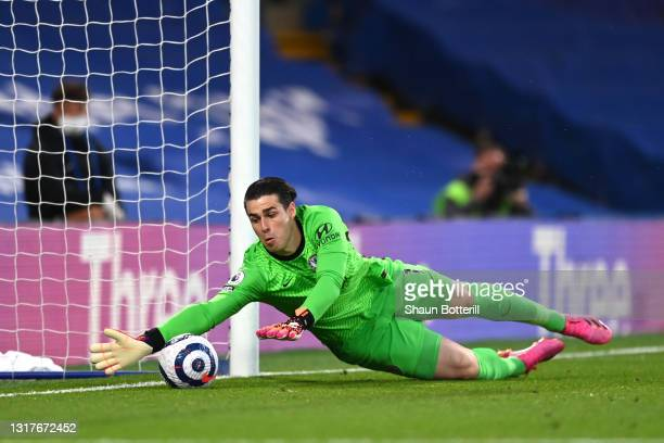 Kepa Arrizabalaga of Chelsea makes a save prior to Emile Smith Rowe of Arsenal scoring their sides first goal during the Premier League match between...