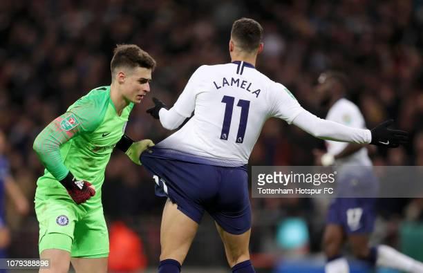 Kepa Arrizabalaga of Chelsea pulls Erik Lamela of Tottenham Hotspur shorts during the Carabao Cup SemiFinal First Leg match between Tottenham Hotspur...