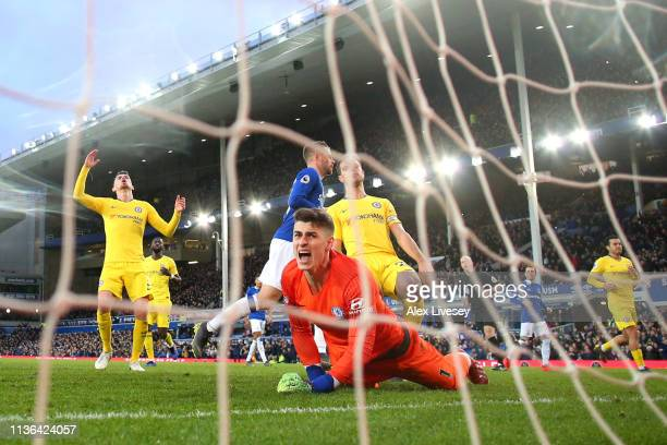 Kepa Arrizabalaga of Chelsea reacts after Gylfi Sigurdsson scores his sides second goal during the Premier League match between Everton FC and...
