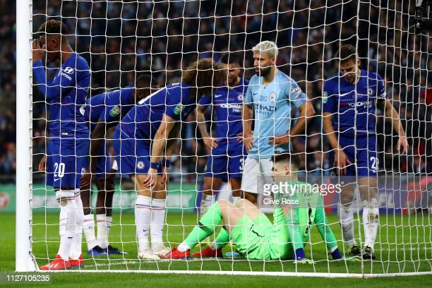 Kepa Arrizabalaga of Chelsea reacts as he goes down injured during the Carabao Cup Final between Chelsea and Manchester City at Wembley Stadium on...