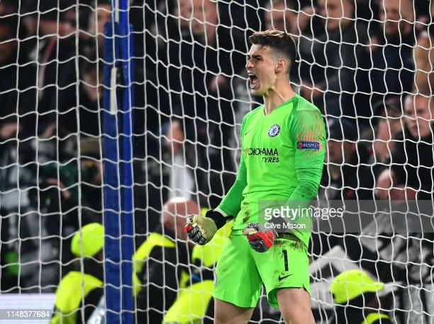 Kepa Arrizabalaga of Chelsea reacts as he saves a penalty with his legs during the penalty shootout during the UEFA Europa League Semi Final Second...