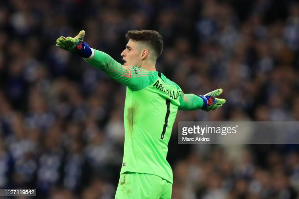 Kepa Arrizabalaga of Chelsea reacts as Maurizio Sarri tries to substitute him during the Carabao Cup Final between Chelsea and Manchester City at...