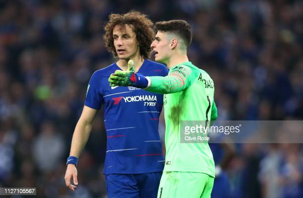 Kepa Arrizabalaga of Chelsea reacts with David Luiz of Chelsea as he refuses to be substituted during the Carabao Cup Final between Chelsea and...