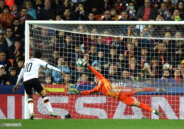 Kepa Arrizabalaga of Chelsea saves a penalty from Daniel Parejo of Valencia during the UEFA Champions League group H match between Valencia CF and...